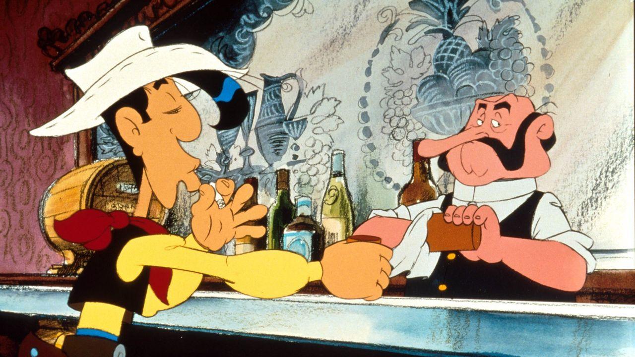 Lucky Luke bestellt beim Barmann einen Drink im Saloon